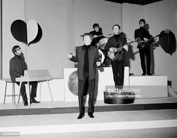 The British pop group Manfred Mann appearing on Top of the Pops circa 1965 Leftright Manfred Mann Paul Jones Mike Hugg Mike Vickers and Tom McGuiness