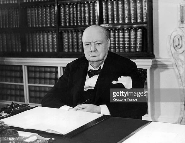 The British Prime Minister Winston CHURCHILL at his desk in 10 Downing Street London the day of his 79th birthday