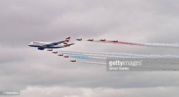 CONTENT] The British Red Arrows are flying in a V formation with an Airbus A380 The British Red Arrows are trailing red white and blue smoke