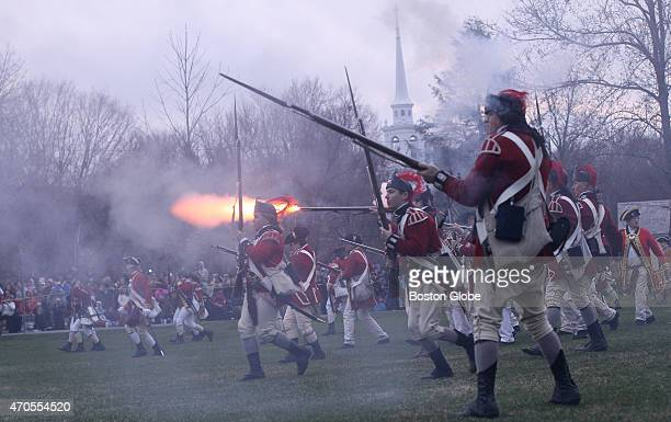 The British Regulars fire during the reenactment of the Battle of Lexington to commemorate the 240th Anniversary of the first day of the American...