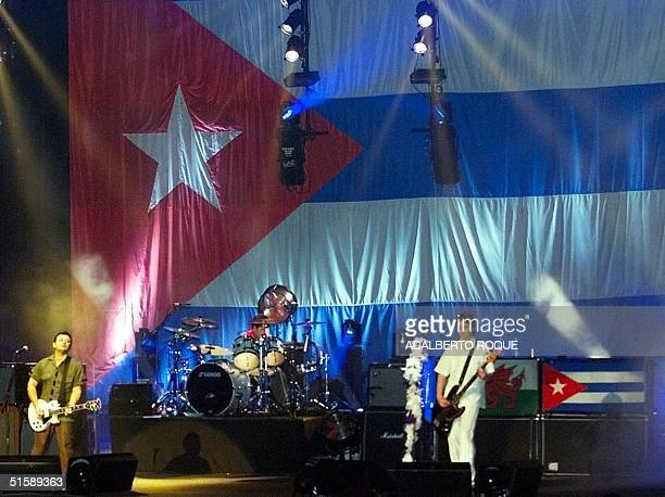 The British rock band Manic Street Preachers performs on the stage of the Karl Marx Theater in Havana 17 February 2001 with the Cuban flag as a...