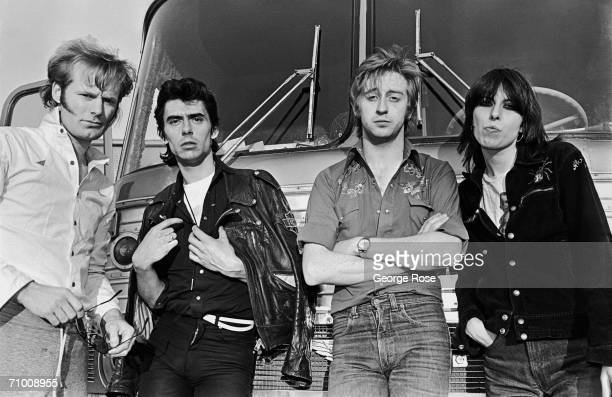 The British rock band The Pretenders pose in front of their tour bus during their first American 1980 concert tour stop in Nashville Tennessee By '83...