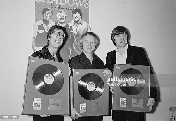 The British rock band The Shadows holds framed records after a concert for 2000 fans at Theatre Mogador in Paris Hank Marvin Brian Bennett and Bruce...