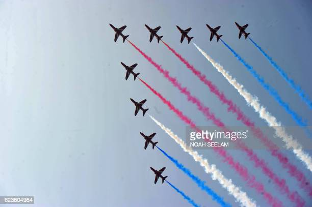 TOPSHOT The British Royal Air Force aerobatic team the 'Red Arrows' perform manoeuvres at the Indian Air Force Academy Dundigal on the outskirts of...