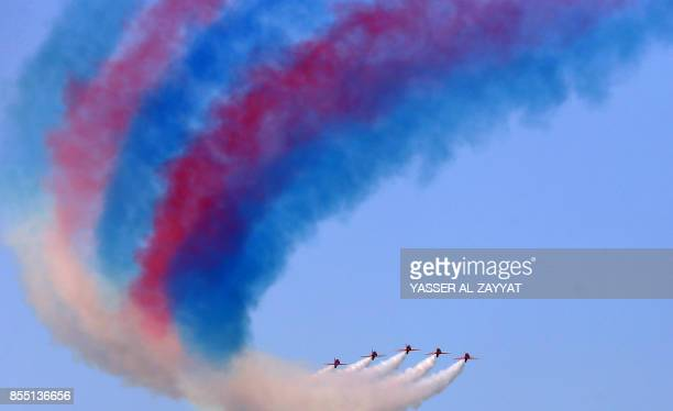 The British Royal Air Force's aerobatic team the 'Red Arrows' performs aerial manoeuvres during an airshow in Kuwait City on September 28 2017 / AFP...