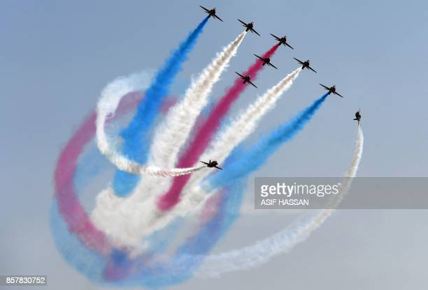 The British Royal Air Force's aerobatic team the 'Red Arrows' performs aerial manoeuvres during an airshow at Sea View in Karachi on October 5 2017 /...