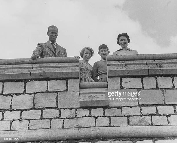 The British Royal family the Duke of Edinburgh Princess Anne Prince Charles and Queen Elizabeth II pictured looking down from the East Terrace Wall...