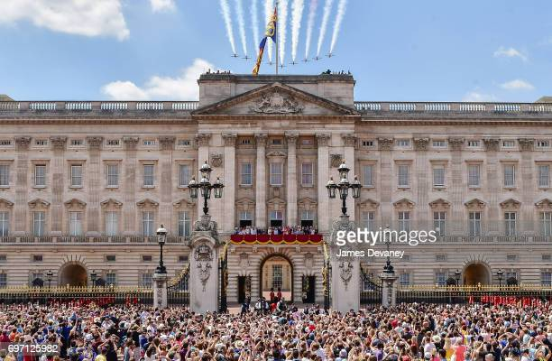 The British Royal family watch the Red Arrows fly over Buckingham Palace during the Trooping the Colour parade on June 17 2017 in London England