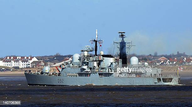 The British Royal Navy Type 42 destroyer HMS Liverpool leaves the mouth of the River Mersey for the final time at New Brighton northwest England on...
