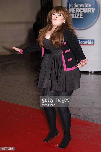 The British singer Adele performs a few dance steps on the wet carpet on arrival for the Mercury Music Awards in Central London on September 9, 2008....