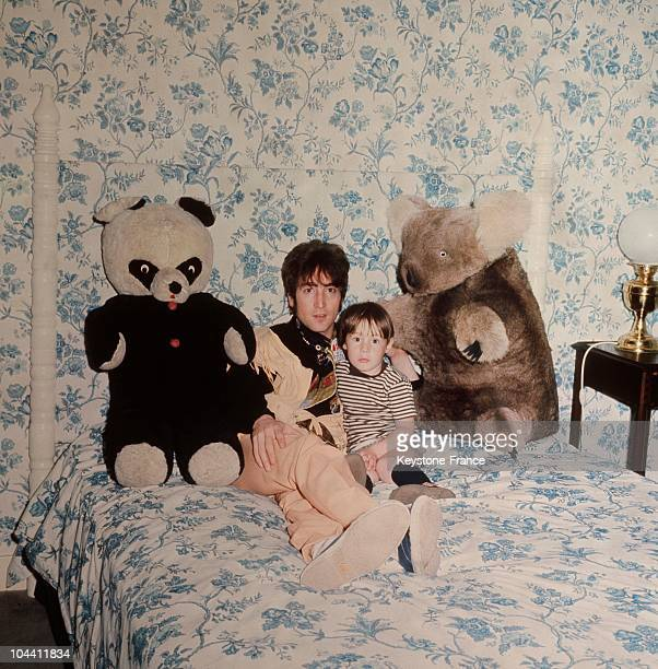 The British singer John LENNON a member of the group THE BEATLES posing in his son's bedroom in his house in Liverpool