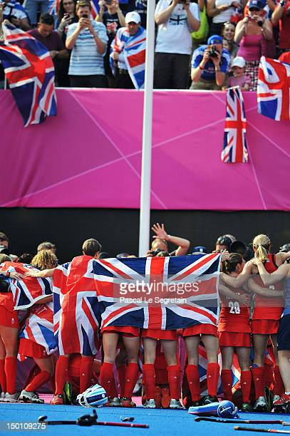 The British team celebrates after winning the Women's Hockey bronze medal match against New Zealand on Day 14 of the London 2012 Olympic Games at...