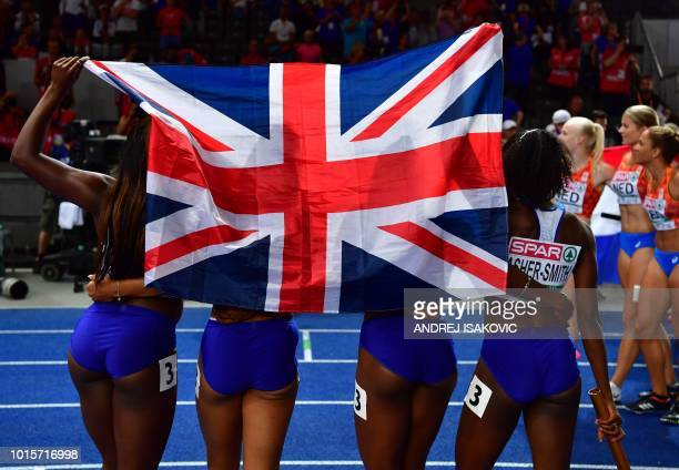 The British team celebrates winning the women's 4x100m relay final during the European Athletics Championships at the Olympic stadium in Berlin on...