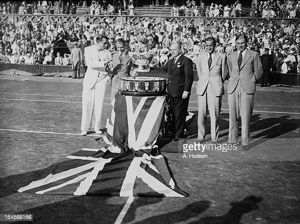 The British team with the trophy on the Centre Court at Wimbledon after retaining the Davis Cup London 30th July 1935 Left to right Fred Perry Bunny...
