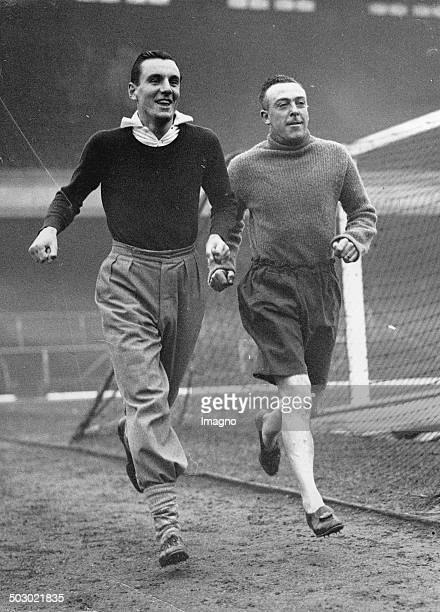 The British tennis player Fred Perry trained with Joe Hulme . Arsenal Stadium. London. 21th February 1936. Photograph.
