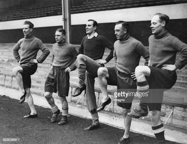 The British tennis player Fred Perry trains with football players Male - Hulme - Roberts and Heasley . Arsenal Stadium. London. 21th February 1936....