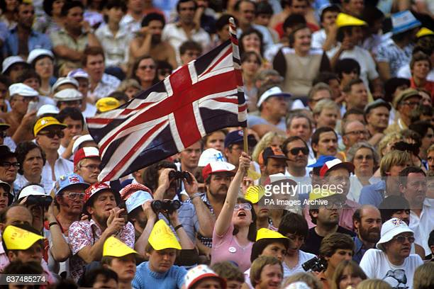 The British Union Flag flies amongst the crowd watching the 1980 Olympic games in Lenin Stadium Moscow