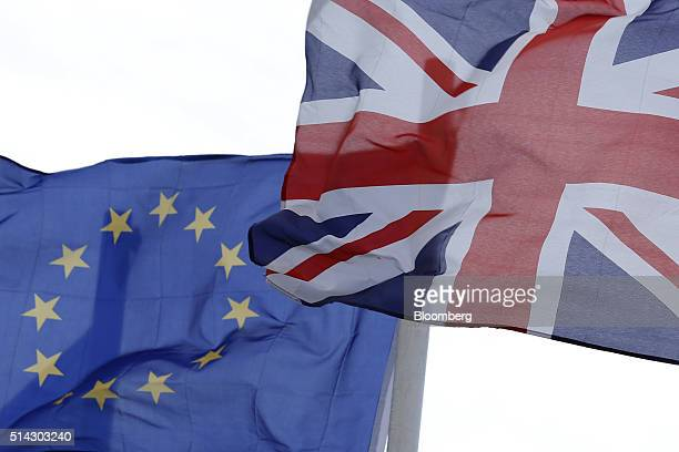 The British Union Flag right and the flag of the European Union fly from flagpoles outside a hotel in Gibraltar UK on Sunday March 6 2016 Gibraltar...