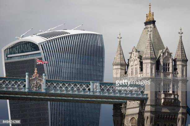 The British Union Jack flag flies from the highlevel walkway of Victorianera Tower Bridge near the modern Walkie Talkie building on 14th September...