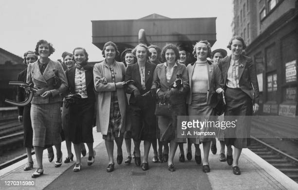 The British women's athletic team leave Victoria Station in London for Vienna in Austria, where they will compete in the European Championships, 14th...