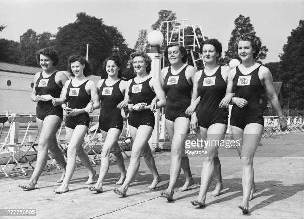 The British women's swimming team taking part in the 1948 Summer Olympics, the XIVth Olympiad in London, England, 1948. From left to right, they are...