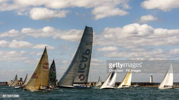 The British yacht ICAP Leopard cuts through the fleet as they pass Hurst Light in the eastern Solent during the 45th Rolex Fastnet Race on the Solent...