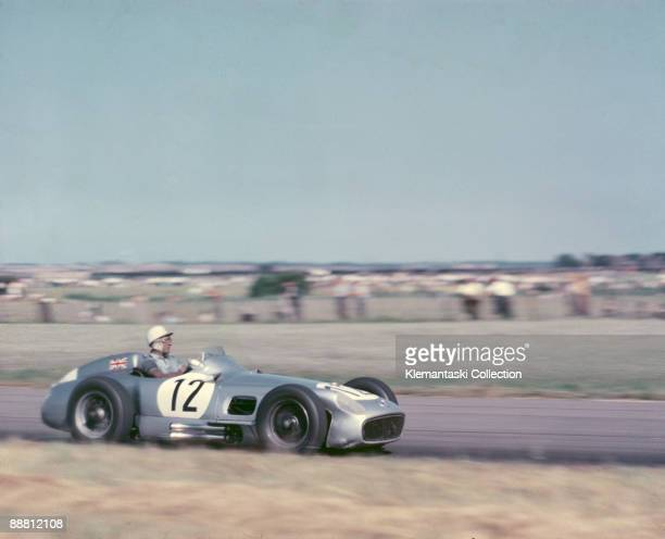 The Britsh Grand Prix, Aintree, July 16, 1955. Stirling Moss drives his Mercedes-Benz through the flat Aintree fields on his way to victory.