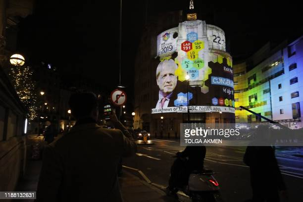 The broadcaster's exit poll results projected on the outside of the BBC building in London shows Britain's Prime Minister Boris Johnson's...