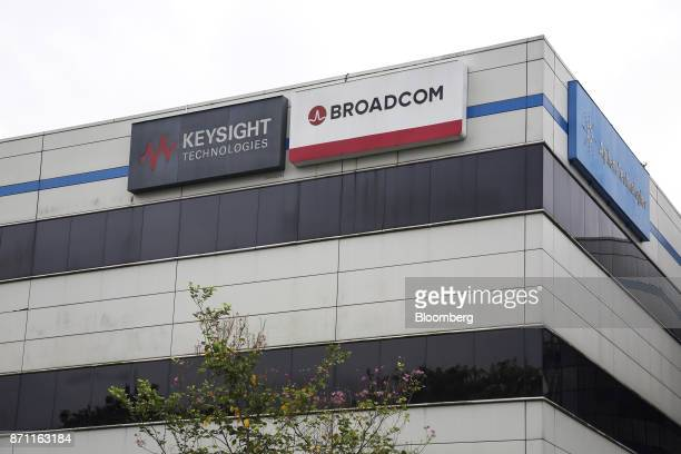 The Broadcom Ltd logo is displayed atop the company's headquarters in Singapore on Tuesday Nov 7 2017 BroadcomChief Executive Officer Hock Tan is...