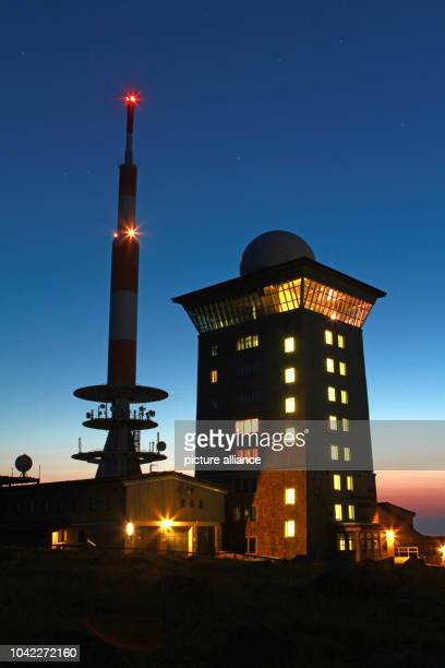 The Brocken Transmitter is litup at dusk on Brocken Mountain near Schierke Germany 08 July 2013 Even at night there is a fantastic view for hikers on...