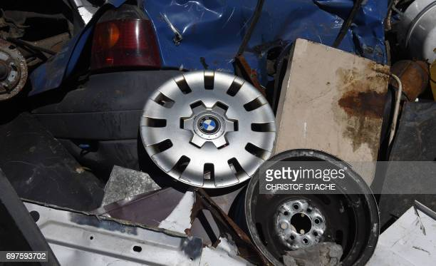 The broken BMW hubcap is seen at a scrap yard in Fuerstenfeldbruck southern Germany on June 19 2017 / AFP PHOTO / Christof STACHE