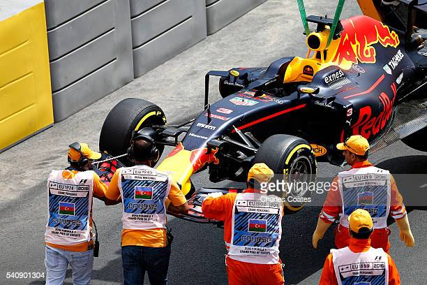 The broken car of Daniel Ricciardo of Australia and Red Bull Racing is removed from the track during practice for the European Formula One Grand Prix...