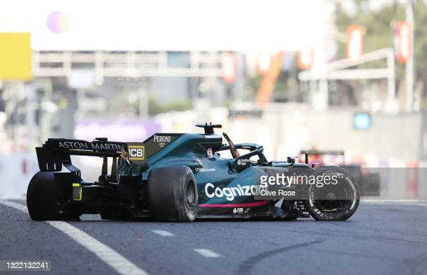 The broken car of Lance Stroll of Canada and Aston Martin F1 Team is seen on the track after a crash during the F1 Grand Prix of Azerbaijan at Baku...