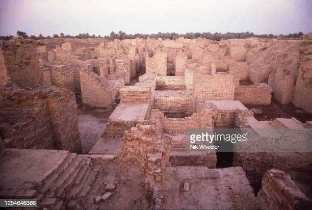 The broken mud brick walls of the archaeological site of Babylon, capital of the ancient kingdom of Babylonia built between the 18th and 6th...