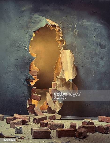 the broken wall - demolishing stock pictures, royalty-free photos & images