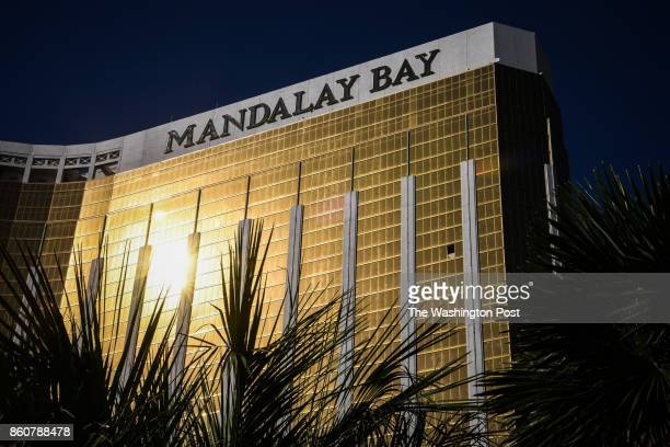 The broken window on the 32nd floor of the Mandalay Bay Hotel and Casino where Stephen Paddock the gunman who killed 59 people and wounded more than...