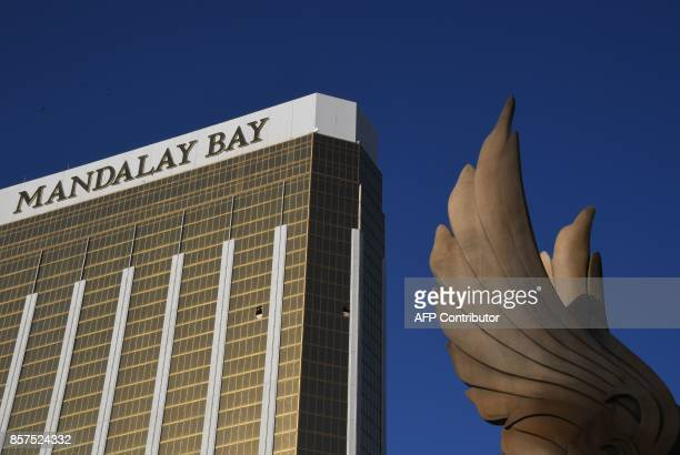 TOPSHOT The broken windows in the Mandalay Hotel on the Las Vegas Strip where a gunman fired from are seen on October 4 2017 on the Las Vegas Strip...