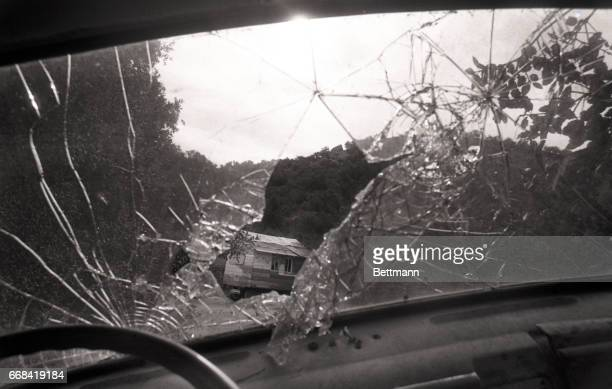 The broken windshield of an abandoned car frames a broken down cabin in Spahn Ranch a former movie ranch in this community north of Los Angeles