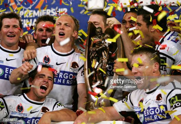 The Broncos celebrate with the premiership trophy during the NRL Grand Final match between the Brisbane Broncos and the Melbourne Storm at Telstra...