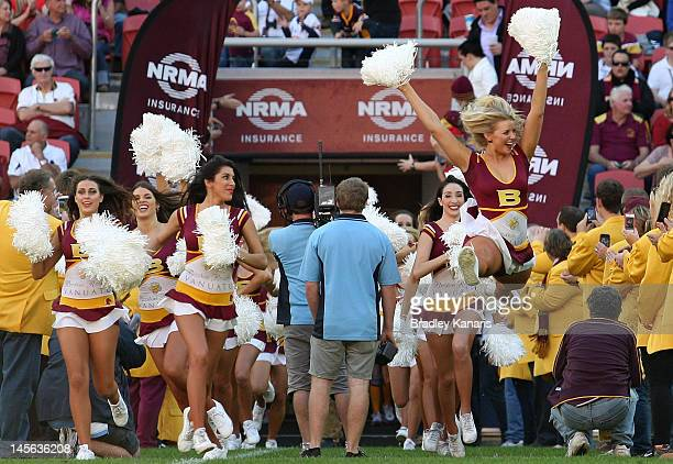 The Broncos cheerleaders make their entrance before the round 13 NRL match between the Brisbane Broncos and the Newcastle Knights at Suncorp Stadium...