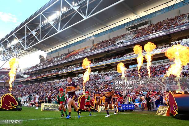 The Broncos run out to the ground during the round 13 NRL match between the Brisbane Broncos and the Gold Coast Titans at Suncorp Stadium on June 09...