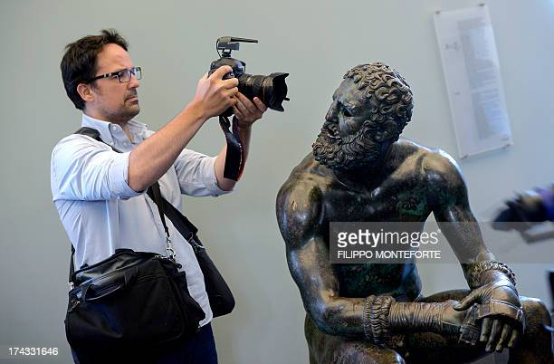 The bronze Boxer of Quirinal also known as the Terme Boxer is photographed after returning from New York to Rome's National Roman Museum on July 24...