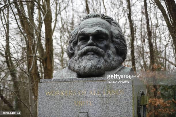 The bronze bust on top of the monument at the tomb of German revolutionary philosopher Karl Marx, a Grade I-listed monument, is seen in Highgate...