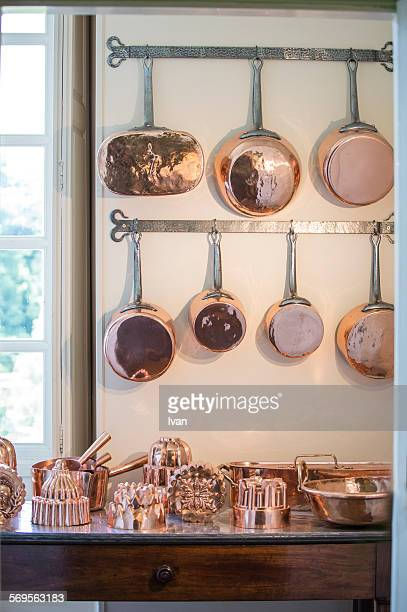 The bronze cookers in a sunny kitchen