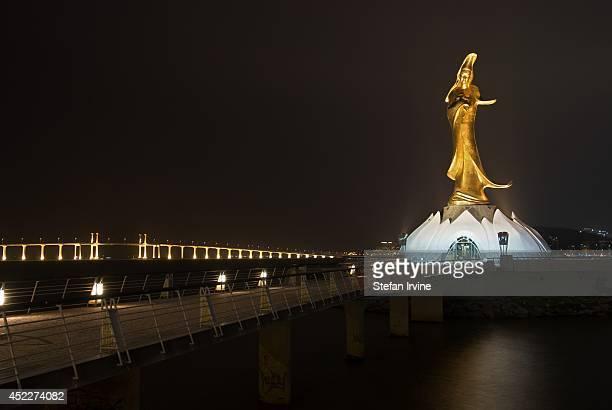 The bronze Kun Lam statue and the Amizade Bridge