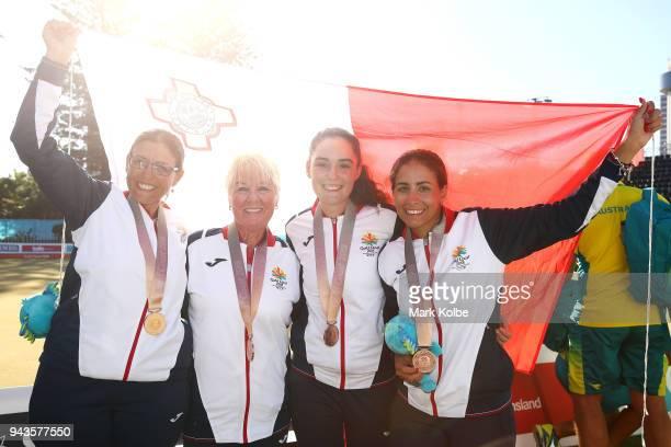 The bronze medal winning team of Rebecca Rixon Rosemaree Rixon ConnieLeigh Rixon Sharon Callus of Malta pose after the victory ceremony for the...