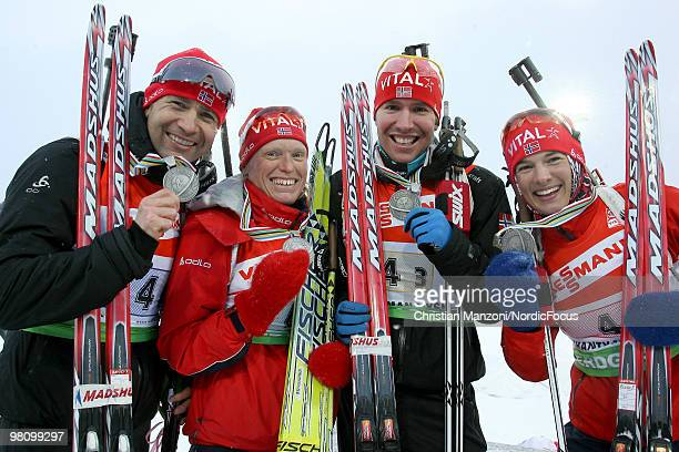 The bronze medallists Ole Einar Bjoerndalen Tora Berger Emil Hegle Svendsen and Ann Kristin Flatland of Norway show their medal after the relay mixed...