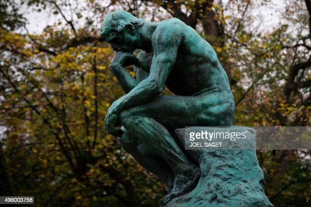 The bronze sculpture 'The Thinker' by French sculptor Auguste Rodin is picutred in front of the Hotel Biron housing the Musee Rodin in Paris on...
