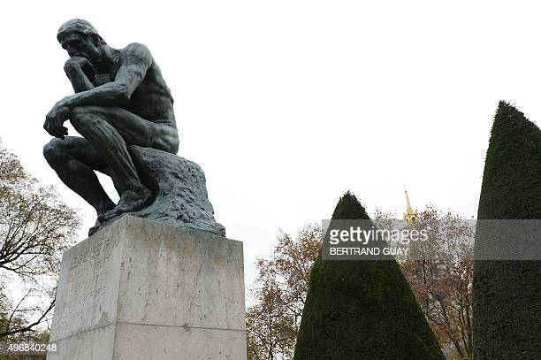 The bronze sculpture 'The Thinker' by French sculptor Auguste Rodin is pictured in the garden of the Hotel Biron housing the Musee Rodin in Paris on...