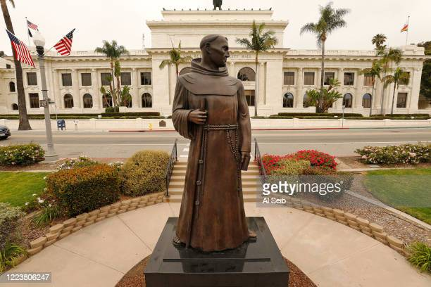 The bronze statue of Father Junipero Serra who founded nine Spanish missions in California including Mission San Buenaventura stands in front of...